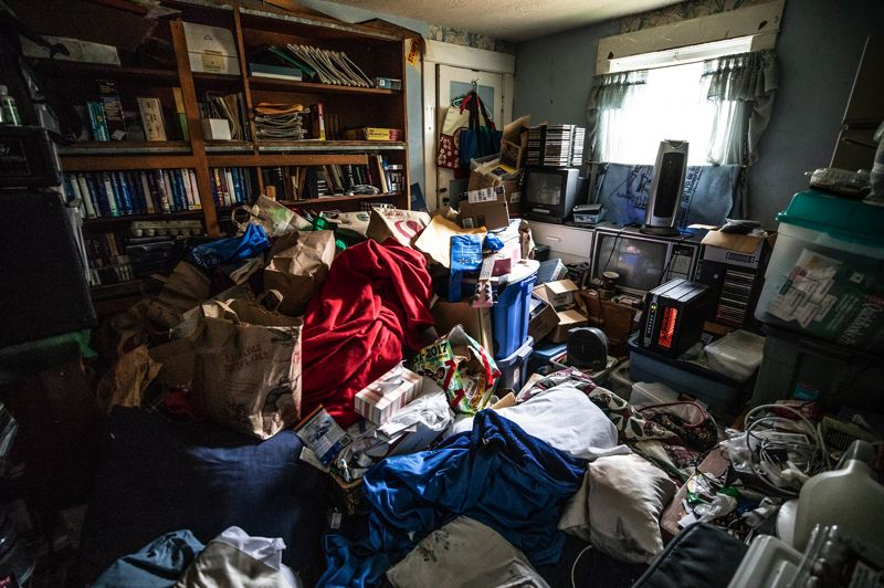 TRIBUNE PHOTO: JONATHAN HOUSE - An impossible to navigate bedroom in a SE Portland hoarder home.