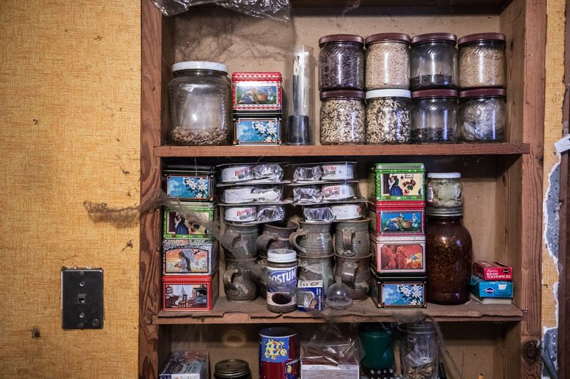 TRIBUNE PHOTO: JONATHAN HOUSE - Cobwebs collect over a shelf of food at a hoarder home.
