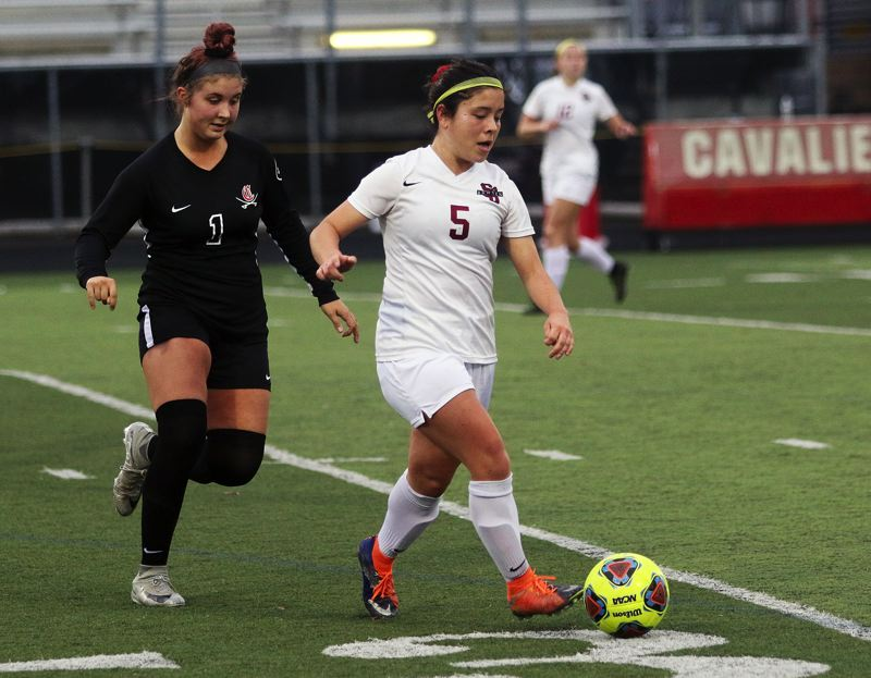 TIMES PHOTO: DAN BROOD - Sherwood senior Gillian Peden (5) controls the ball in front of Clackamas senior Ellie Gentry during Saturday's state playoff match.