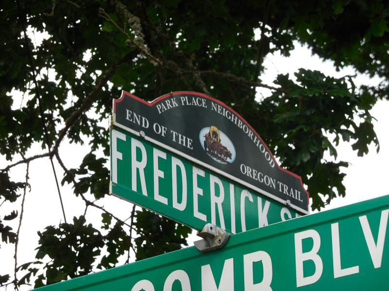 SUBMITTED PHOTO - Street sign toppers identify the Park Place Neighborhood as the final stretch of the Oregon Trail.