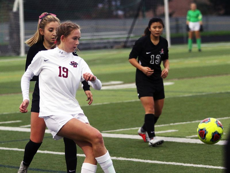 TIMES PHOTO: DAN BROOD - Sherwood High School sophomore Joley Sproul boots the ball forward during the Lady Bowmen's state playoff match at Clackamas.
