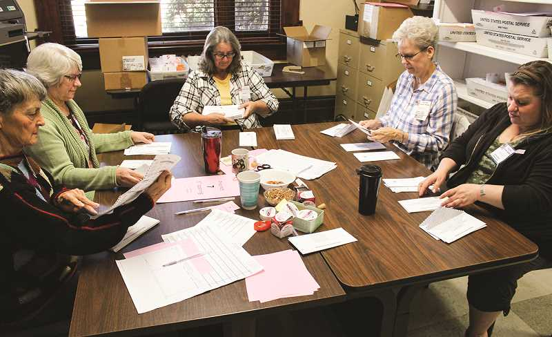 JASON CHANEY - The Crook County ballot opening board is hard at work on Friday morning, helping prepare for counting local votes on election night. Pictured clockwise from bottom left are Nancy Knoche, Donna Adams, Kathy Riley, Trisha Shrum and Jessica Streit.