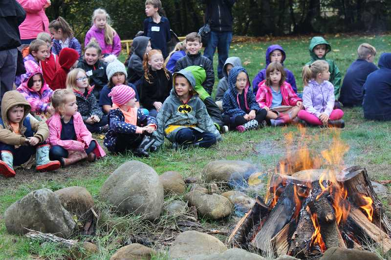PIONEER PHOTO: KRISTEN WOHLERS - MRA students gather around the bonfire to conclude their annual Roots Day Oct. 31.