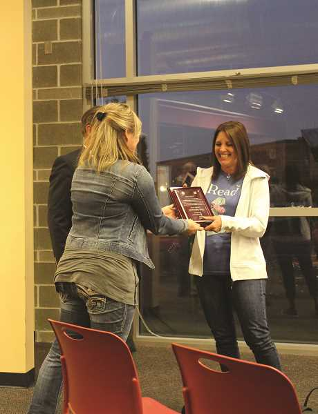 HERALD PHOTO: KRISTEN WOHLERS - Eccles librarian Gini Saltmarsh receives the October CARE Award.