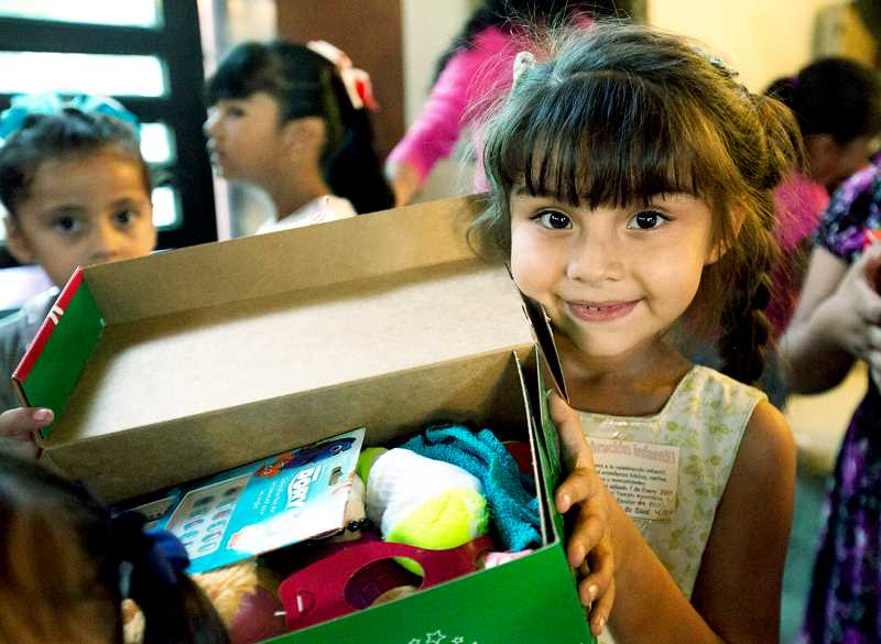 PHOTO COURTESY OF SAMARITAN'S PURSE - Boxes packed locally for Operation Christmas Child are shipped around the world through the nonprofit Samaritan's Purse organization.