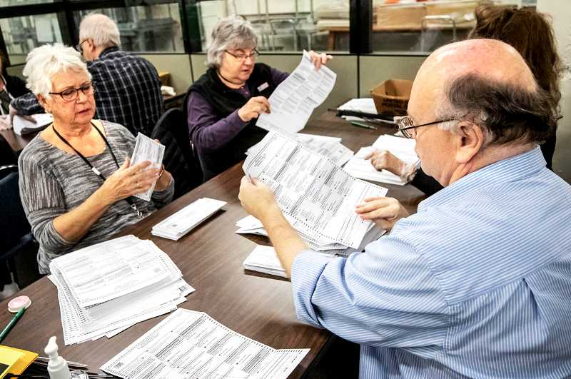 FILE PHOTO - Ballot processors are busy this week tabulating the results of the Oregon general election.