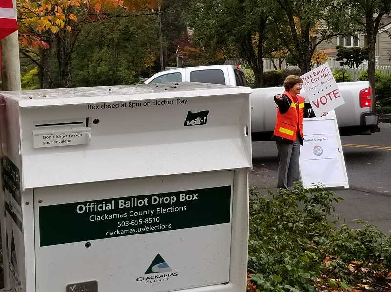 REVIEW PHOTO: GARY M. STEIN - A cadre of City staff, volunteers (including Rotarian Linda Brown, above) and even a city councilor or two will be on hand Tuesday to direct traffic and point voters in the right direction.