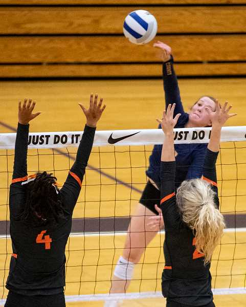 LON AUSTIN/CENTRAL OREGONIAN - Raegan Wilkins goes up for a kill against Crater Saturday morning at the state tournament. Wilkins led the Cowgirls in kills with 19 on Friday against West Albany and 11 on Saturday against Crater.