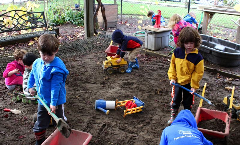 STAFF PHOTO: OLIVIA SINGER - The outdoor play area has a major focus on nature with wagons, a giant sand box and a garden, among other elements.