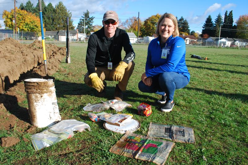 COURTESY PHOTO: HSD - Former Brookwood Elementary first grade teacher Terry Sayre, who led the capsule burial 20 years ago, and current principal of the school Michelle Jensen assisted in Friday's dig-up.