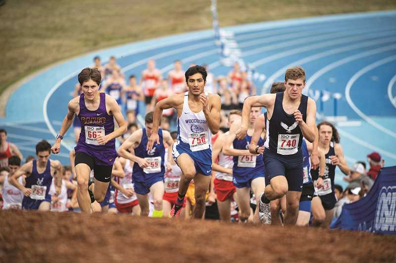 LON AUSTIN - Woodburn senior Giovanni Bravo (middle) made his third consecutive trip to the cross country state championship race in Eugene, where he placed on the top-10 podium for the second straight year.