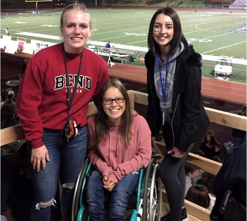 SUBMITTED PHOTO  - Lauren Lafreneire, left, Kayla Bolnick and Phoebe Johnson enjoy a WHS football game from the new platform.