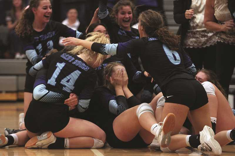 PHIL HAWKINS - The St. Paul volleyball team collapsed in celebration after defeating the Powder Valley Badgers 3-1 on Saturday in the 2018 1A Volleyball State Championship game at Ridgeview High School in Redmond.