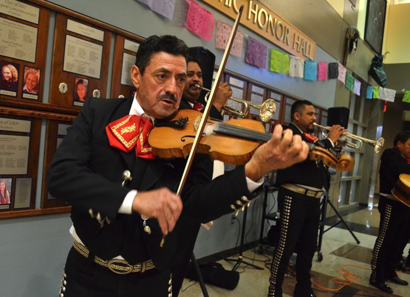 SPOKESMAN PHOTO: VERN UYETAKE  - Jose Iglesias and the rest of his band entertains the crowd at Thursday's Day of the Dead event.