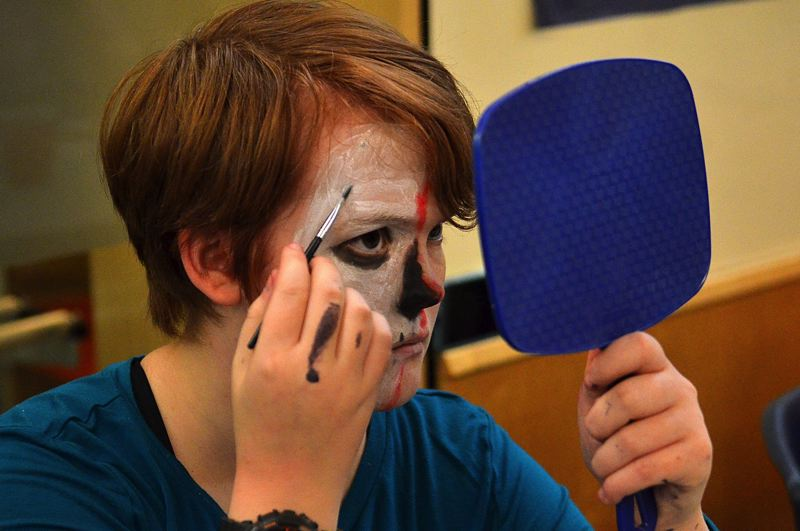 SPOKESMAN PHOTO: VERN UYETAKE  -  Wilsonville High School sophomore Katy Tueck paints her Day of the Dead face.