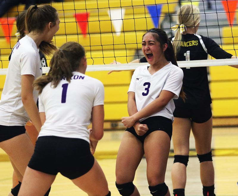 TIMES PHOTO: DAN BROOD - Horizon Christian junior setter Jazzy Lazaro lets out a yell after the Hawks scored a point against South Umpqua in Friday's state tournament quarterfinal match.