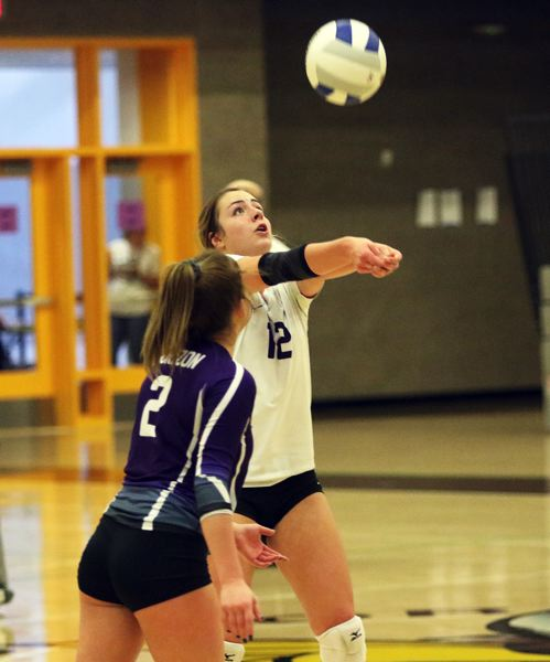 TIMES PHOTO: DAN BROOD - Horizon Christian senior Lauren Eyerly (12), in front of senior libero Maddie Jones, keeps the ball in play during action Friday at the Class 3A state tournament.