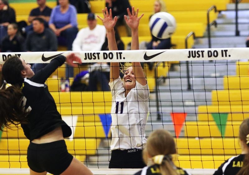 TIMES PHOTO: DAN BROOD - Horizon Christian senior Jaycie Forrester (11) goes up for a block during the Hawks' state tournament match with South Umpqua.