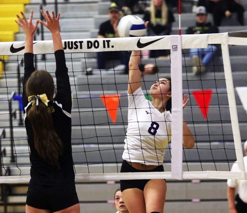 TIMES PHOTO: DAN BROOD - Horizon Christian senior Becca Classen (8) goes up for a kill during the Hawks' state tournament match with South Umpqua.