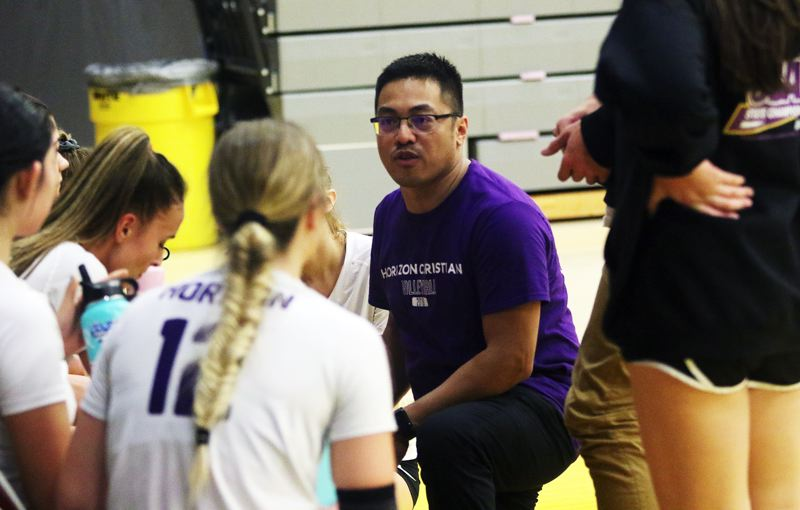 TIMES PHOTO: DAN BROOD - First-year Horizon Christian coach Jay Lazaro talks with the Hawks during a time out in Friday's Class 3A state tournament match.