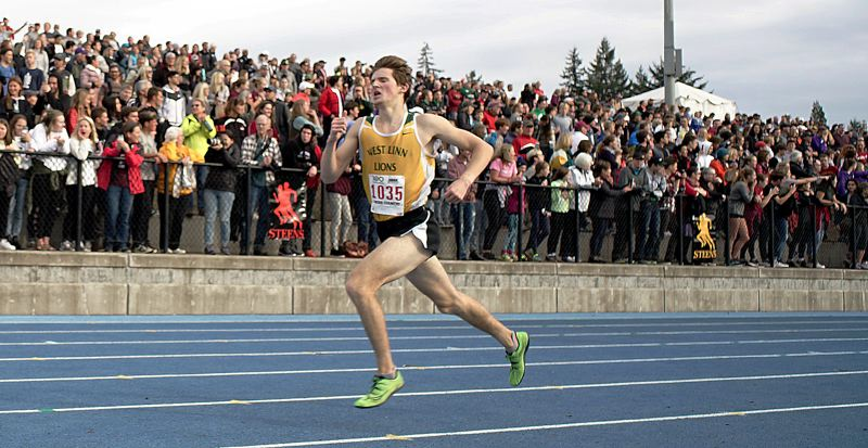 TIDINGS PHOTO: KIT MCAVOY - West Linn senior Kenney McElroy speeds down the home stretch to finish 14th at the Class 6A state cross country meet at Lane Community College on Saturday.