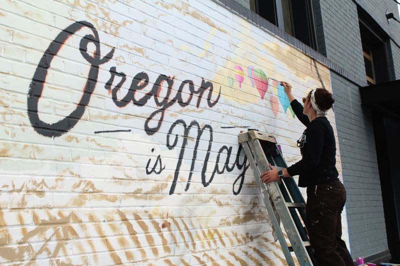STAFF PHOTO: OLIVIA SINGER - Beaverton resident and artist Holly Henderson was tasked with completing the downtown Forest Grove mural — part of a series of murals across the state.