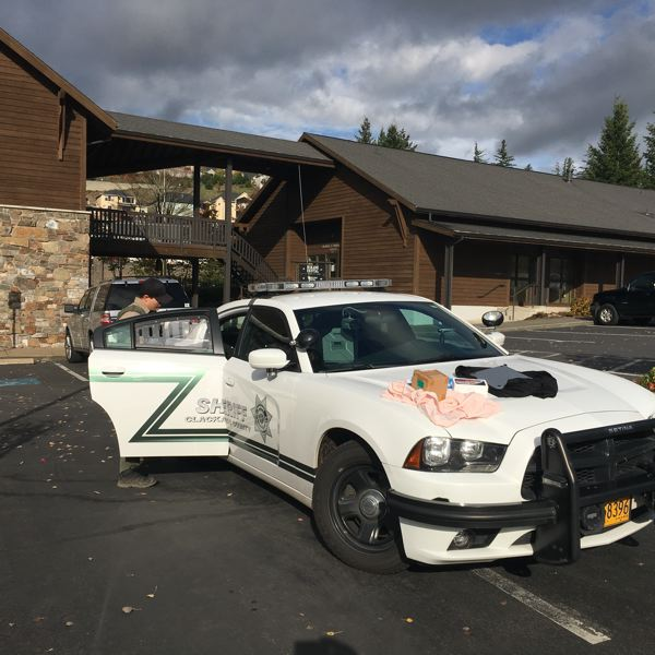 PHOTO COURTESY: CCSO - A Clackamas County deputy's patrol car prepares to leave the arrest scene near Goddard School and dental offices in Happy Valley.