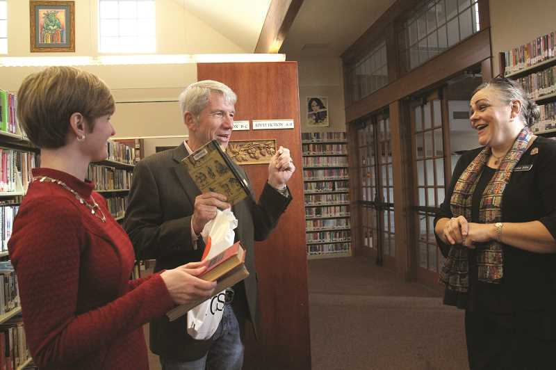 LINDSAY KEEFER - Kurt Schrader talks with library director Jackie Mills (right) and library youth services coordinator Hannah Bostrom about the Mount Angel Public Library's recent cleaning out of outdated volumes from its collection during a Nov. 2 visit.