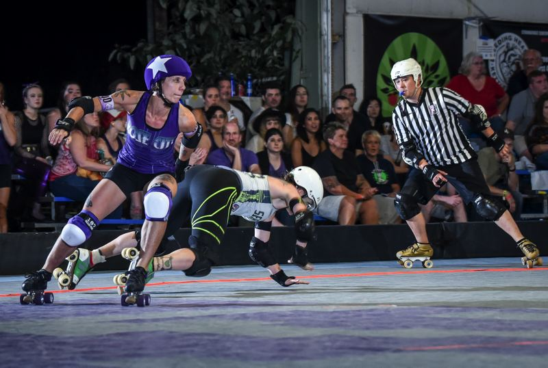 COURTESY: BILL ZINGRAF/REGULARMAN PHOTOGRAPHY - Bonnie Thunders (left) of the Rose City Rollers makes a move on the track. She and the Wheels of Justice all-star team will compete this week in the international championships.