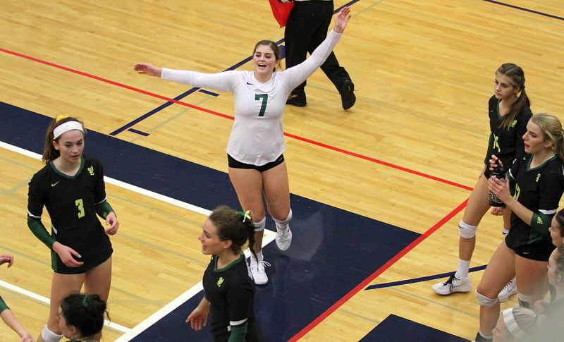 TIDINGS PHOTO: MILES VANCE - West Linn senior libero Ellie Snook leads cheers during her team's 3-1 quarterfinal win over Sheldon at the Class 6A state tournament at Liberty High School on Friday.