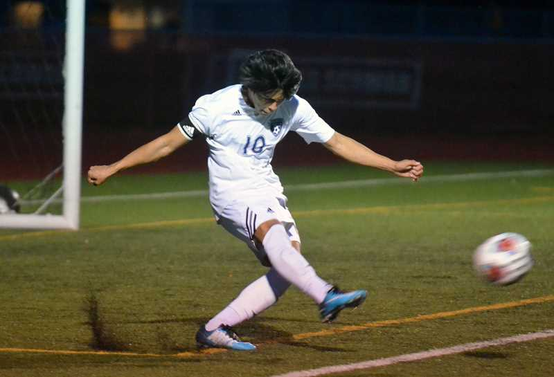 SPOKESMAN PHOTO: TANNER RUSS - Junior defender Henry Tellez takes a goal kick against the Central Panthers. Wilsonville was defeated in the quarterfinals 1-0.