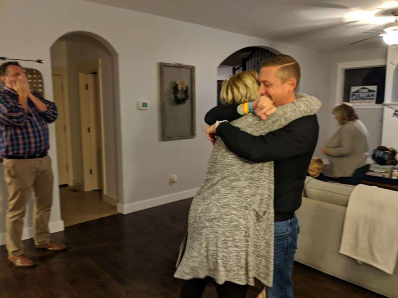 CONTRIBUTED PHOTO - Mayoral candidate Stan Pulliam hugs his wife in celebration of early results in his favor.