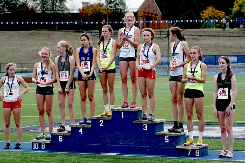 PHOTO BY KIT MACAVOY - Tualatin High School junior Kaitlyn Gearin (far right) earned a spot on the award stand at the Class 6A state cross country championships.