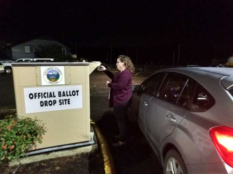 SPOTLIGHT PHOTO: COURTNEY VAUGHN - Jaime Holstein drops off a ballot on election night Tuesday, Nov. 6 at the Columbia County Courthouse dropbox before polls closed at 8 p.m. By 8 p.m., Columbia County elections officials reported roughly 15,000 ballots remaining to be counted.