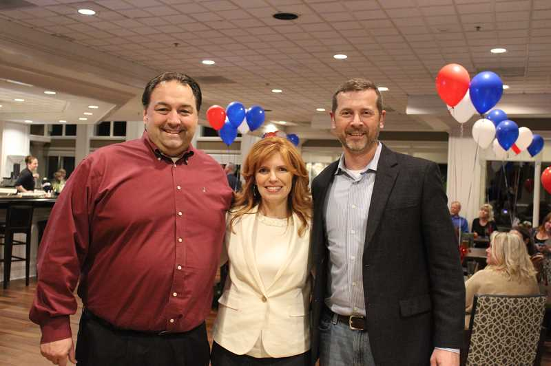 HERALD PHOTO: KRISTEN WOHLERS - Christine Drazan celebrates at Willamette Valley Country Club on Nov. 6 alongside supporters, including Canby Mayor Brian Hodson (left) and her husband Dan Drazan (right).