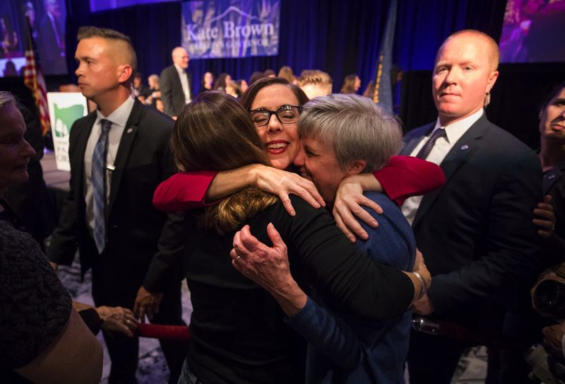 PAMPLIN MEDIA GROUP PHOTO: JONATHAN HOUSE - Gov. Kate Brown hugs supporters Tuesday night after winning re-election in a tight race with state Rep. Knute Buehler.
