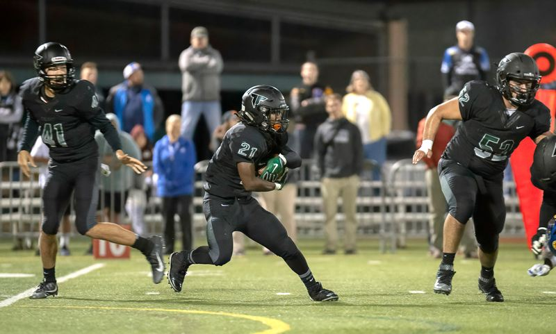 COURTESY PHOTO: CHRISTOPER GERMANO - Tigard senior running back Malcolm Stockdale ran for three first-quarter touchdowns in the 54-12 state playoff win over Aloha.