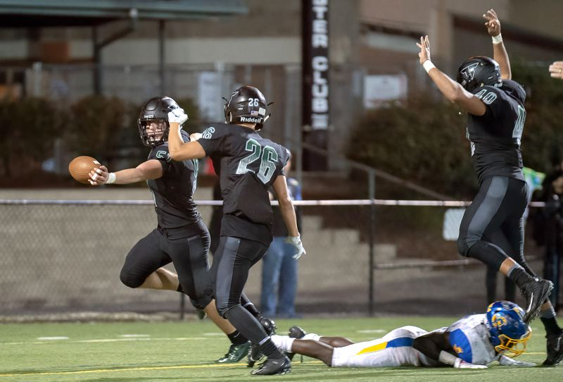 COURTESY PHOTO: CHRISTOPER GERMANO - Tigard senior linebacker Mitchell Cross (51) gets to the end zone to complete a 30-yard fumble return for a touchdown during the playoff win oer Aloha.