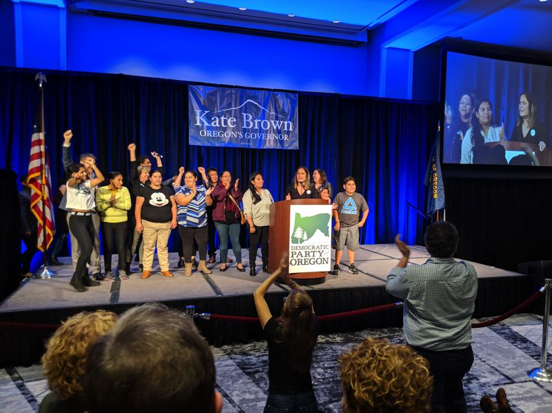 PAMPLIN MEDIA GROUP: JOSEPH GALLIVAN - At the podium is Andrea Williams, chair of the No on Measure 105 campaign and Executive Director of CAUSA the immigrant rights organization, and her team, at the Democratic Party's celebration at the Hilton Hotel on Broadway.