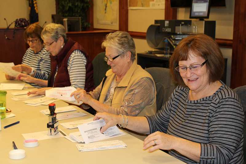 HOLLY M. GILL/MADRAS PIONEER - Volunteers count some of the last ballots received on Tuesday, Nov. 6, at the Jefferson County Courthouse Annex. From right to left, they include Lynn Weisen, Connie Howland, Sharon Comingore and Lorelee Dendauw.