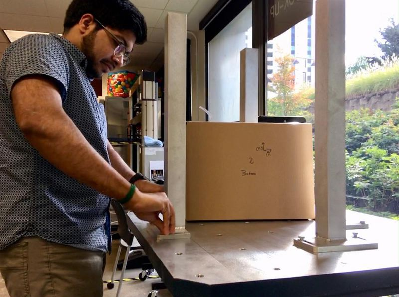 BILLERUDKORSNäS DESIGNERS USE A SHAKING MACHINE TO TEST THE PROTECTIVE POWER OF THE PAPER PACKAGING THEY CREATE.CASSANDRA PROFITA/OPB/EARTHFIX - BillerudKorsnäs designers use a shaking machine to test the protective power of the paper packaging they create.