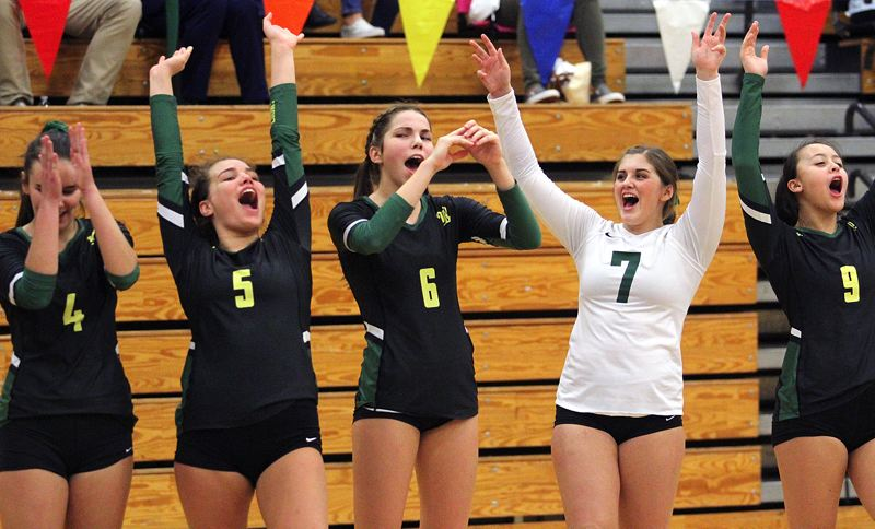 TIDINGS PHOTO: MILES VANCE - West Linn's (from left) Kayla Moss, Ellie Naone, Claire Matthiessen, Ellie Snook and Lauren Knutson had good reason to celebrate at the Class 6A state tournament as the Lions finished third for the second year in a row.