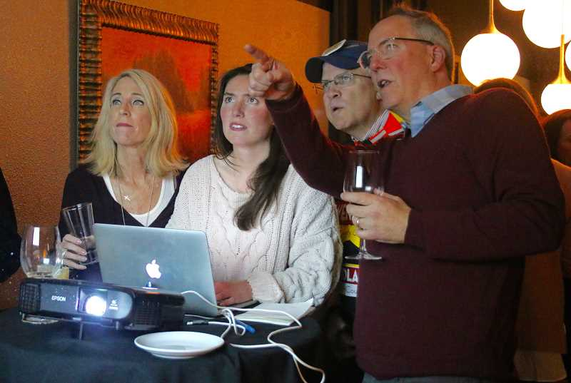 REVIEW PHOTO: J. BRIAN MONIHAN - Lorri Kehoe (from left), Sara Wendland, Bob Wendland and John Wendland watch campaign results Tuesday night during Wendland's campaign party at Nicoletta's Table.