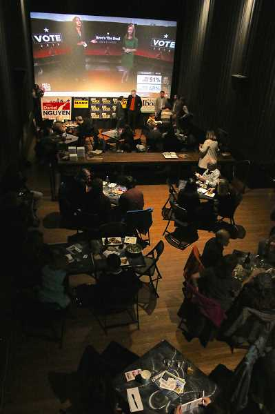 REVIEW PHOTO: J. BRIAN MONIHAN - Community members and candidates watch election-night results on the big screen at the Lake Theater and Cafe in downtown Lake Oswego.