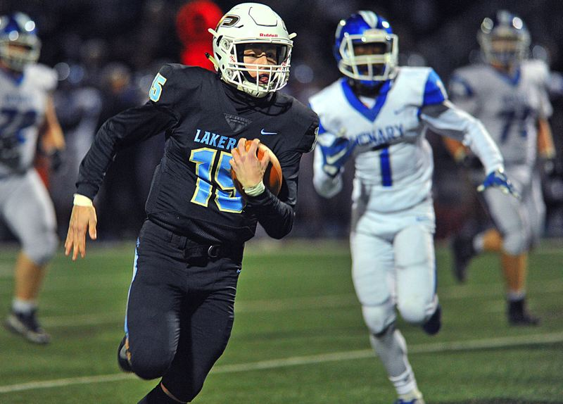 REVIEW PHOTO: VERN UYETAKE - Lakeridge senior quarterback Charlie Maynes made the Play of the Day during his team's Friday win over McNary, taking off 45-yard touchdown run that gave his team a 19-13 lead and set the table for its eventual runaway victory at Lakeridge High School.