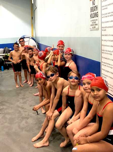 SUBMITTED PHOTO - Madras Swim Team members get ready for their races in Redmond, where 31 members competed.