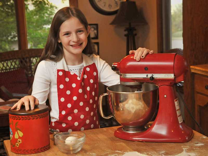 TIDINGS PHOTO: VERN UYETAKE  - Violet Gowdy has challenged herself to bake 50 different desserts in 52 weeks.