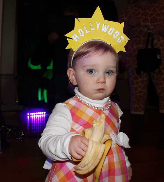 REVIEW PHOTO: CLAIRE HOLLEY - Eighteen-month-old Juliet Williams enjoys a healthy snack at the Monster Mash.