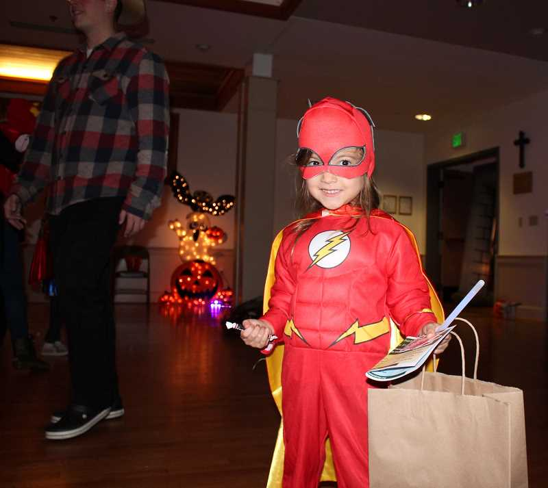 REVIEW PHOTO: CLAIRE HOLLEY - Ciel Antonini shows off her Flash superhero Halloween costume.
