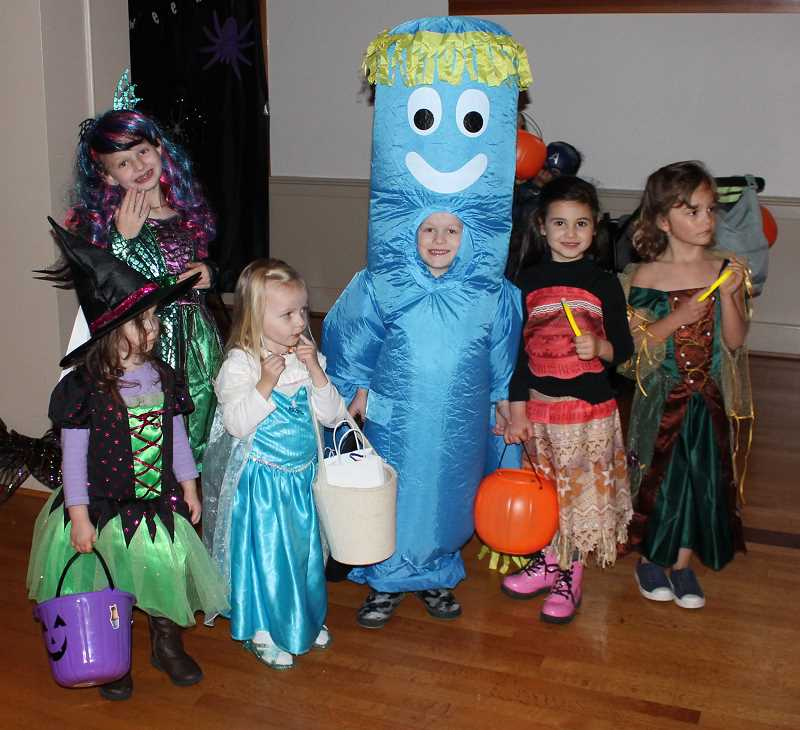 REVIEW PHOTO: CLAIRE HOLLEY - A group of Lake Oswego kikds show off their impressive and creative costume at the Monster Mash.